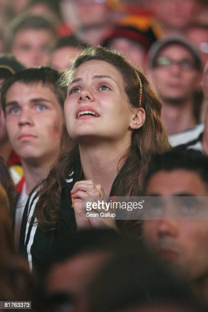 Germany fans react to the final minutes of play at a public viewing at the Fan Mile in front of the Brandenburg Gate after watching the UEFA EURO...