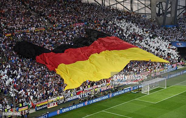 Germany fans spread the giant national flag prior to the UEFA EURO semi final match between Germany and France at Stade Velodrome on July 7 2016 in...