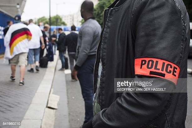 Germany fans walk past a French police officer at the Parc des Princes stadium in Paris on June 21 2016 during the Euro 2016 group C football match...