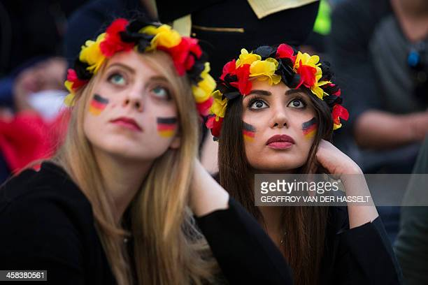 TOPSHOT Germany fans watch the the Euro 2016 quarterfinal football match between Germany and Italy match at the fan zone in Paris on July 2 2016 /...