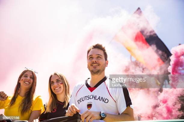Germany fans watching and supporting their team at world competition football league