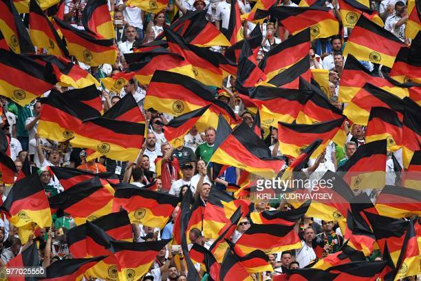 Germany fans wave flags before the Russia 2018 World Cup Group F football match between Germany and Mexico at the Luzhniki Stadium in Moscow on June...