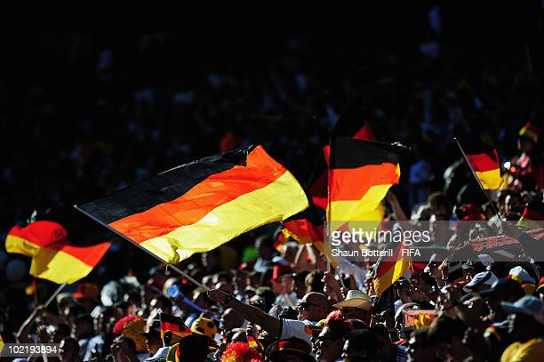 Germany fans wave flags during the 2010 FIFA World Cup South Africa Group D match between Germany and Serbia at Nelson Mandela Bay Stadium on June 18...