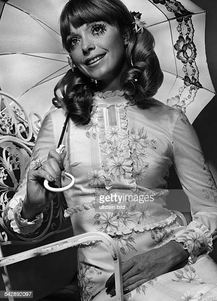 Germany fashion spring / summer 1969 model Gigi wearing a batiste dress made from Dracon polyester fibre and cotton flower ornaments photo by Stephan