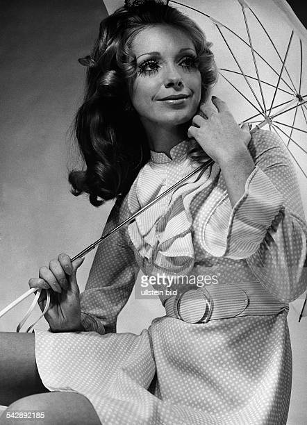 Germany fashion spring / summer 1969 model Gigi wearing a polkadotted dress made from Dracon polyester fibre by DuPont photo by Stephan