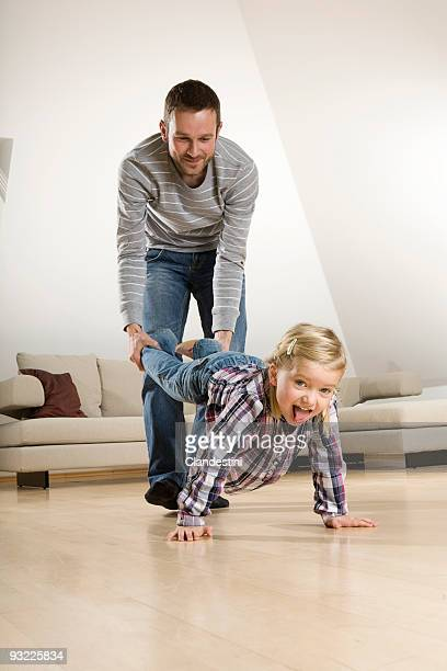 Germany, Father pulling daughter's (2-3) foot