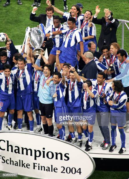 FC Porto players celebrate on the podium after beating Monaco 30 in the final of the Champions League football match 26 May 2004 at the Arena...