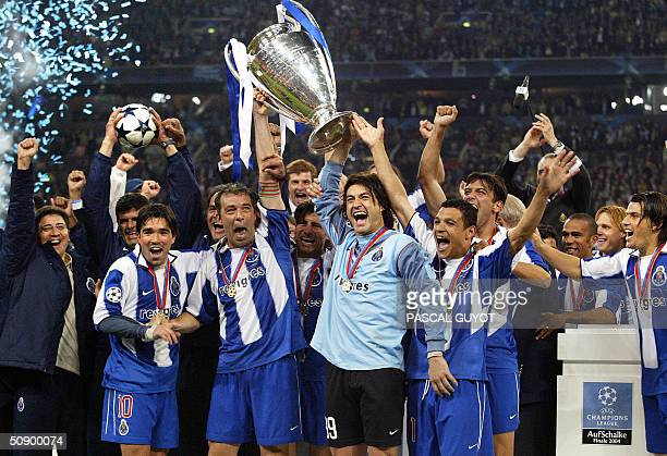FC Porto players celebrate with the trophy after beating Monaco 30 in the final of the Champions league football match 26 May 2004 at the Arena...
