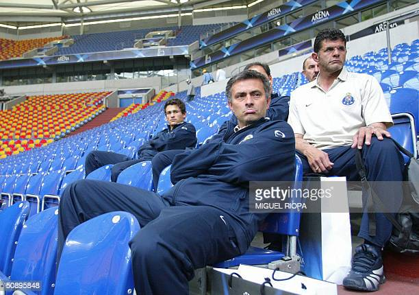 FC Porto trainer Jose Mourinho watches AS Monaco's training session 25 May 2004 in the Arena AufSchalke stadium in the western town of Gelsenkirchen...