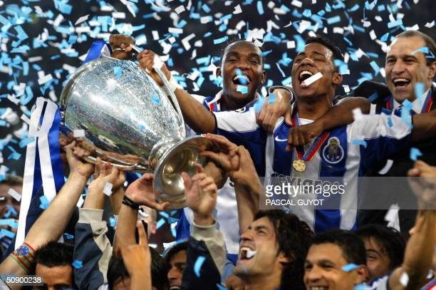 FC Porto's Benni McCarthy and Carlos Alberto hold the trophy as they celebrate with their teamates after beating Monaco 30 in the Champions League...
