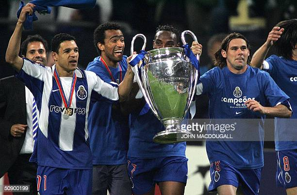 FC Porto's Derlei Jose Bosingwa Benni McCarthy and Maniche run with the trophy after beating Monaco 30 in the final of the Champions league football...