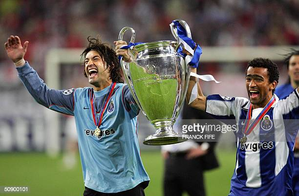 FC Porto's goalkeeper Vitor Baia and Bosingwa hold up the trophy as they celebrate after beating Monaco 30 in the final of the Champions league...