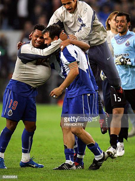 FC Porto's midfielder Carlos Alberto celebrates with his captain Jorge Costa after beating Monaco 30 in the Champions league final footbal match at...