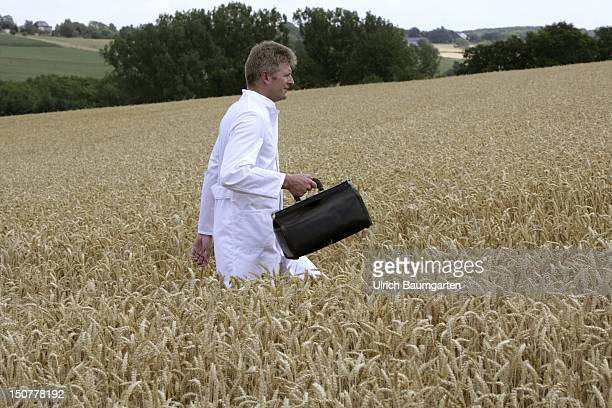 Germany Feature to the topic shortage of doctors in the country Our picture shows a country doctor walks through a cornfield