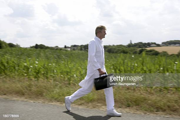 Germany Feature to the topic shortage of doctors in the country Our picture shows a country doctor walks along a field