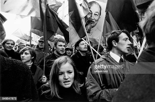Germany February 1968 demonstrations against the war in Vietnam student revolt in Berlin young protesters carrying flags and a poster with the...