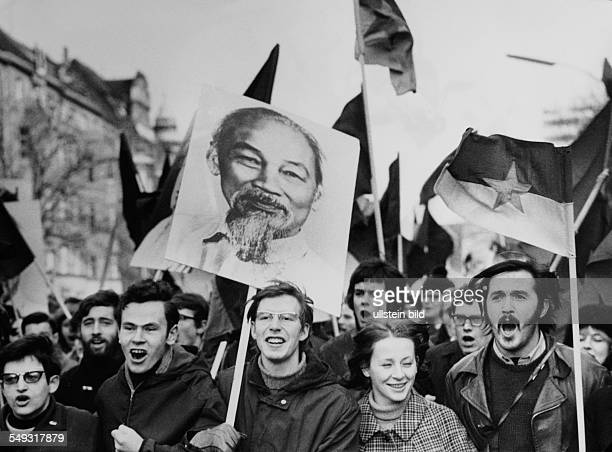 Germany February 1968 Vietnam Demonstrations and student revolt in Berlin young protesters carry flags and poster with photograph of Ho Chi Minh