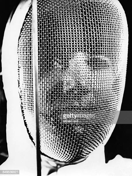 Germany fencer with fencing mask in the 1960's