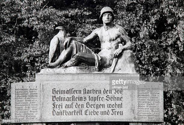 Germany First War memorial in Volmarstein with stone sculpture showing a soldier with eagle