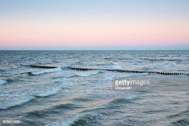 Germany, Fischland-Darss-Zingst, Zingst, Baltic Sea, breakwater in the evening