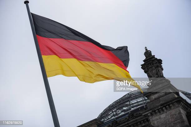 Germany flag at the Reichstag Building or the German Federal Parliament Building in Berlin