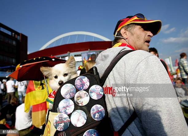 Germany football fan is seen with dog dressed in German colours during the public viewing of the UEFA EURO 2008 Group B match between Austria and...