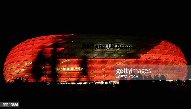 Football fans enter the Allianz-Arena stadium in Munich 18 October 2005 to see the Champions League soccer match of Bayern Munich against Juventus...