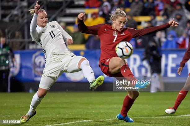 Germany forward Alexandra Popp battles with United States defender Abby Dahlkemper during the game between the United States and Germany on March 01...