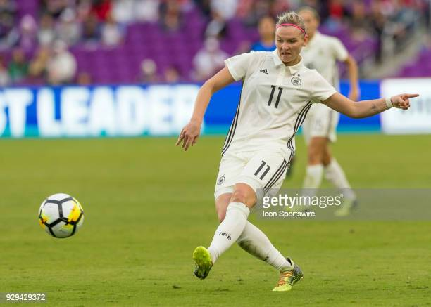 Germany forward Alexandra Popp shoots on goal during the SheBelieves Cup between Germany and France on March 7th 2017 at Orlando City Stadium in...