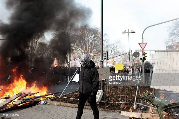 an activist walks past a burnig barricade during a demonstration organized by the Blockupy movement to protest against the policies of the European...