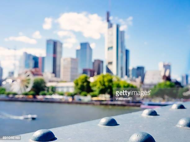 Germany, Frankfurt, blurred view to skyline from Eiserner Steg