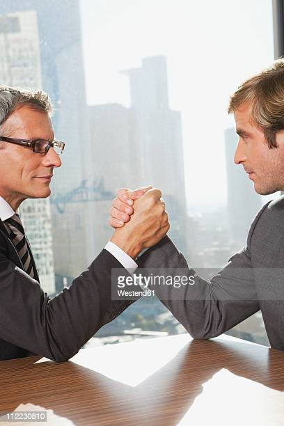 Germany, Frankfurt, Businessmen doing arm wrestling