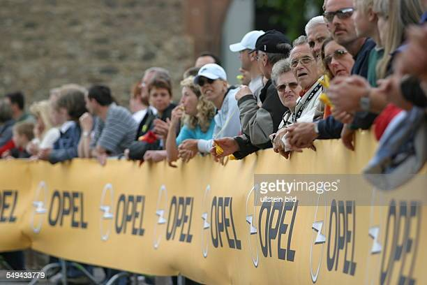 Ironman Look at the spectators behind a cordon