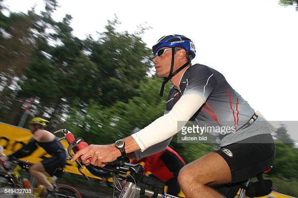 Ironman Look at three participants while they are riding bikes