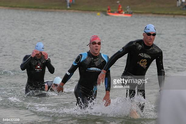 Ironman Three participants in the water