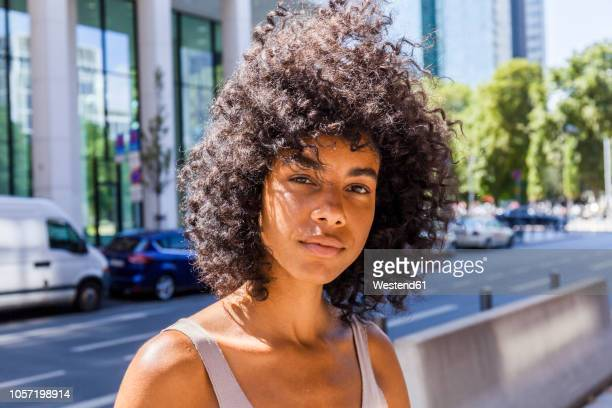 germany, frankfurt, portrait of young woman with curly hair - big hair stock pictures, royalty-free photos & images