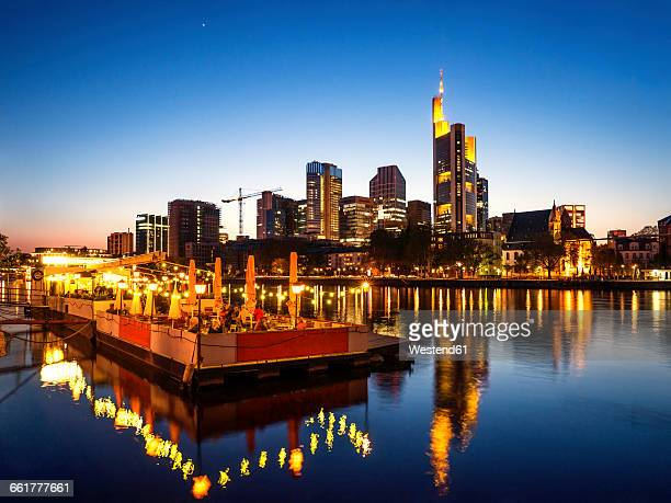 Germany, Frankfurt, skyline with platform on River Main in the evening