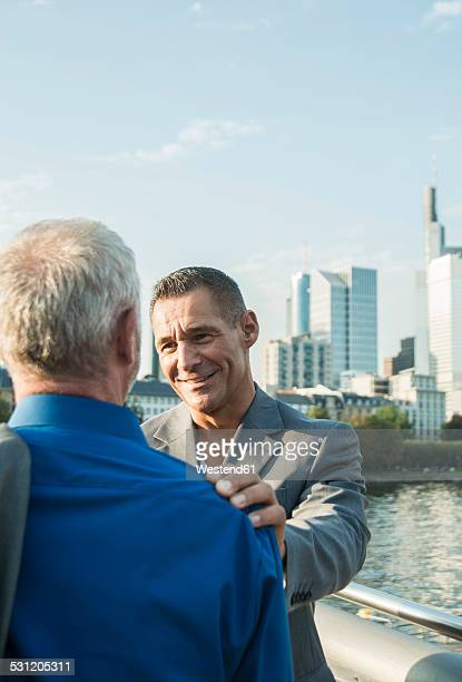 germany, frankfurt, two businessmen on bridge - frankfurt main bildbanksfoton och bilder