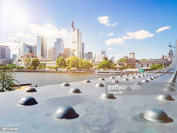 Germany, Frankfurt, view to skyline at backlight with girder of Eiserner Steg in the foreground