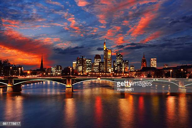 Germany, Frankfurt, view to skyline with Ignatz-Bubis-Bridge and Main River in the foreground by sunset
