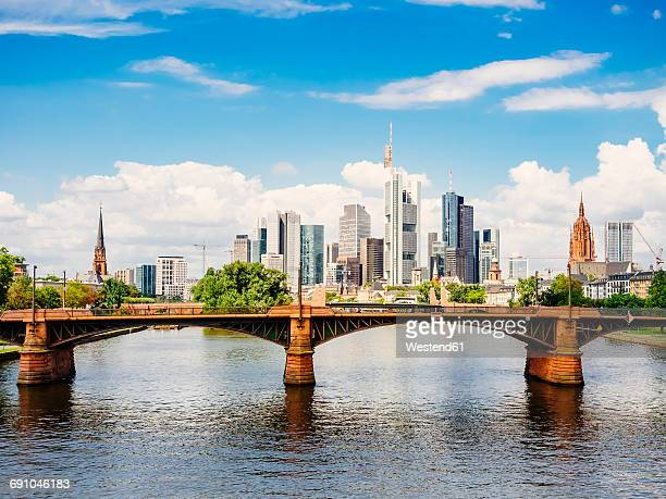 Germany, Frankfurt, view to skyline with Ignatz-Bubis-Bridge and Main River in the foreground