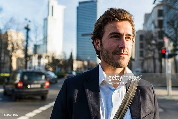germany, frankfurt, young businessman in the city with bicycle, using mobile phone - stubble stock pictures, royalty-free photos & images