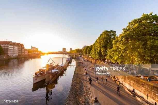 germany, free hanseatic city of bremen, schlachte, weser, riverside, promenade, boats, beer garden, restaurants, sunset - bremen stock pictures, royalty-free photos & images