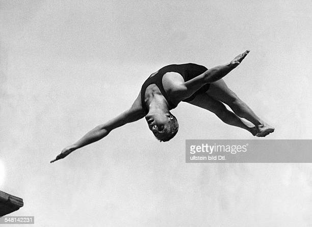 Germany Free State Prussia Berlin 1936 Summer Olympics 3meter springboard diving Olympic champion Richard Degener diving into the pool August 1936...