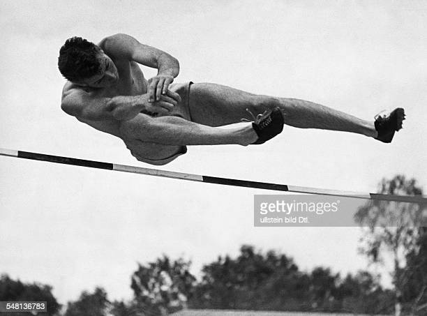 Germany Free State Prussia Berlin 1936 Summer Olympics High jump Delos P Thurber in action August 1936 Photographer Lothar Ruebelt Published by...