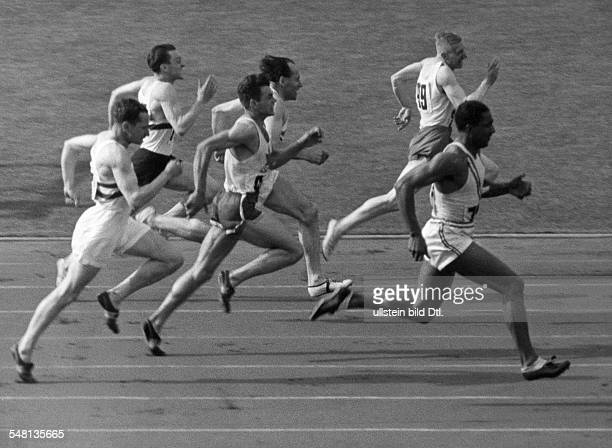 Germany Free State Prussia Berlin 1936 Summer Olympics Men's 100m race Metcal USA ahead of Osendarp Netherlands Borchmeyer Germany and McPhee Canada...