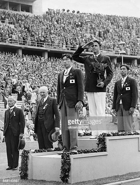 Germany Free State Prussia Berlin 1936 Summer Olympics On the podium during the medal ceremony for polevault from the left Shuhei Nishida Earle...