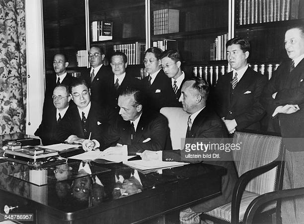 Germany Free State Prussia Berlin : Anti-Comintern Pact German envoy Joachim von Ribbentrop signing the Pact; left: Japanese Embassador Kintomo...