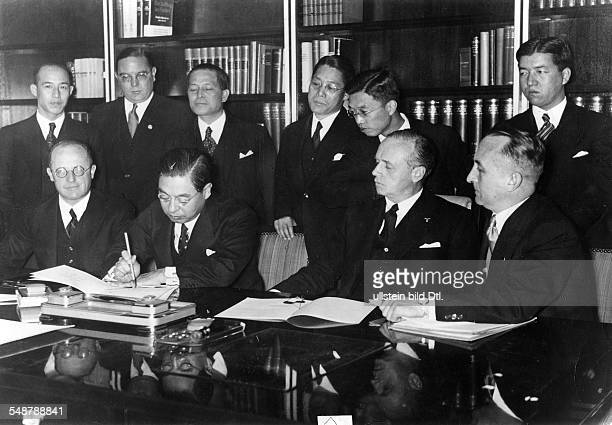 Germany Free State Prussia Berlin : Anti-Comintern Pact Japanese Embassador Kintomo Mushakoji signing the Pact; to his right: German envoy Joachim...