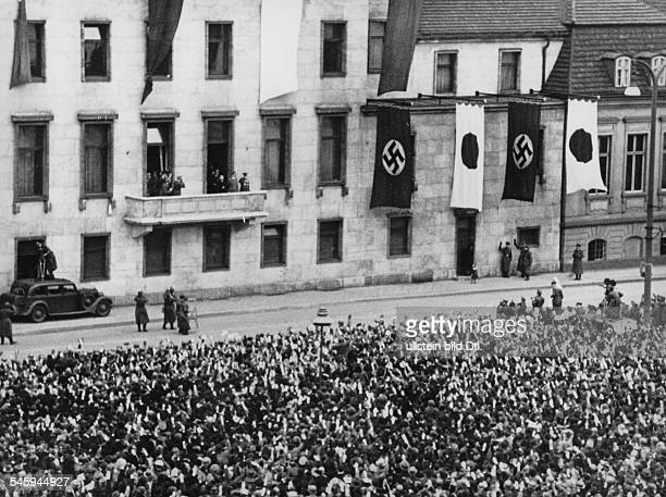 Germany Free State Prussia Berlin Berlin: Adolf Hitler and the japanese foreign minister on the balcony of the Reichskanzlei greeting the cheering...